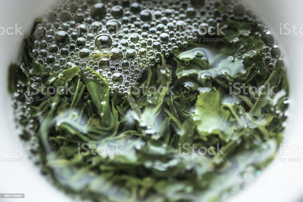 Sencha steeping in a gaiwan teacup with bubbles royalty-free stock photo