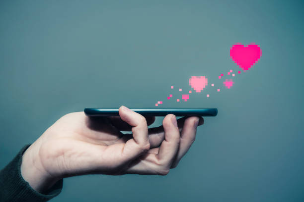 send love with mobile phone - dating stock photos and pictures