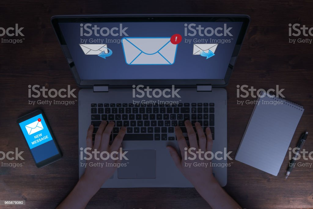 Sending and receiving e mails at late working hours, business, marketing and communication concept - Royalty-free Adult Stock Photo