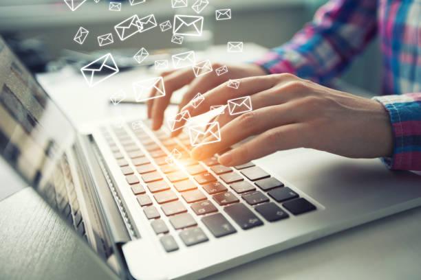 sending e-mail from laptop via web application. - email foto e immagini stock