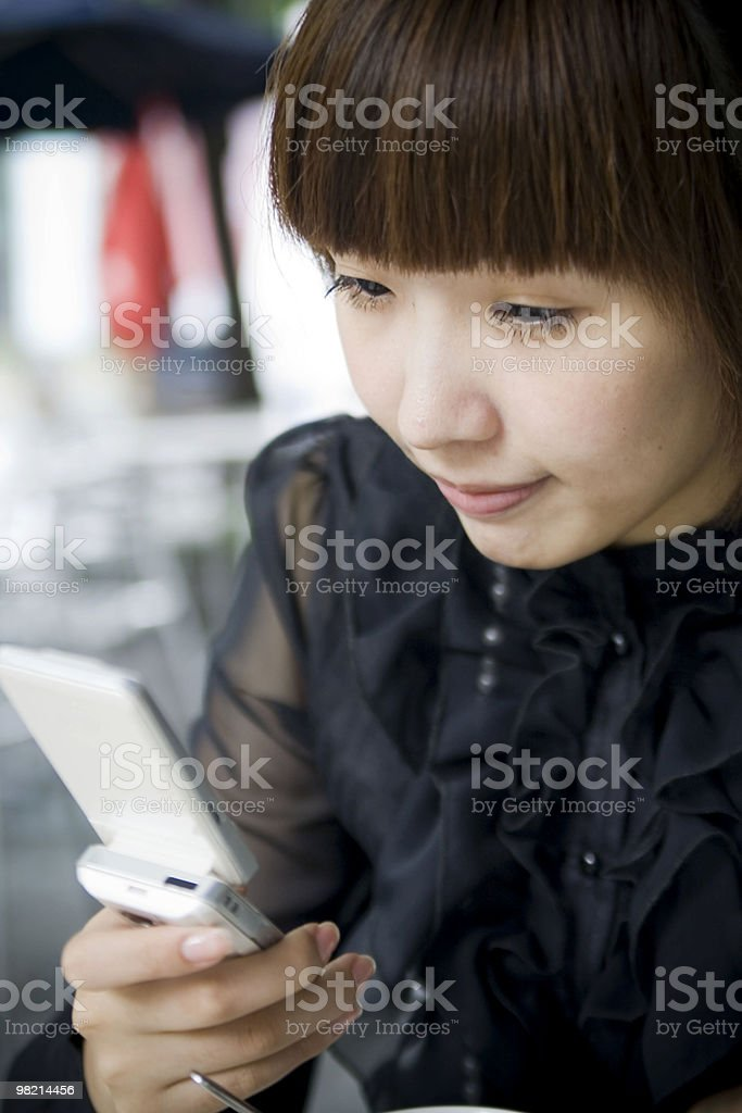 Sending SMS royalty-free stock photo