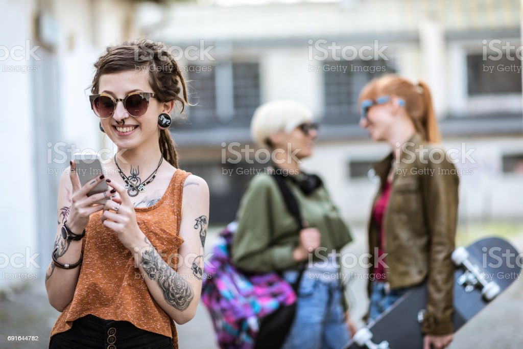 Sending text message to friends stock photo