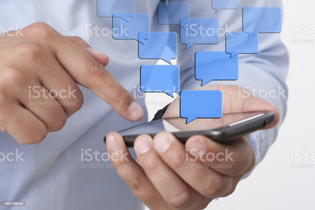sending Text Messaging via Mobile Phone stock photo