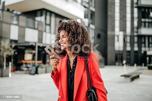 Beautiful businesswoman in read coat on her way to work place