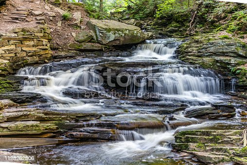 The waters of Kitchen Creek fall gently over shale rock at Seneca Waterfall in Ricketts Glen State Park of Pennsylvania.
