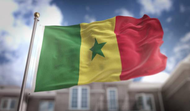 Renderização 3D de Senegal bandeira sobre fundo azul céu edifício - foto de acervo