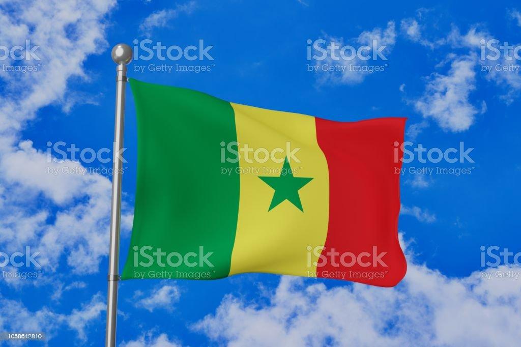 Senegal acenando bandeira nacional isolada no azul céu nublado - foto de acervo