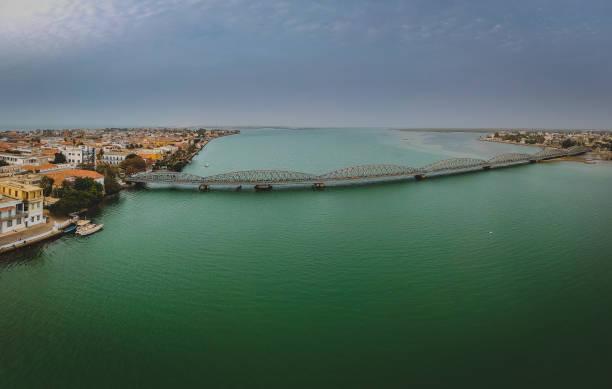 senegal river and faidherbe bridge, - st louis стоковые фото и изображения