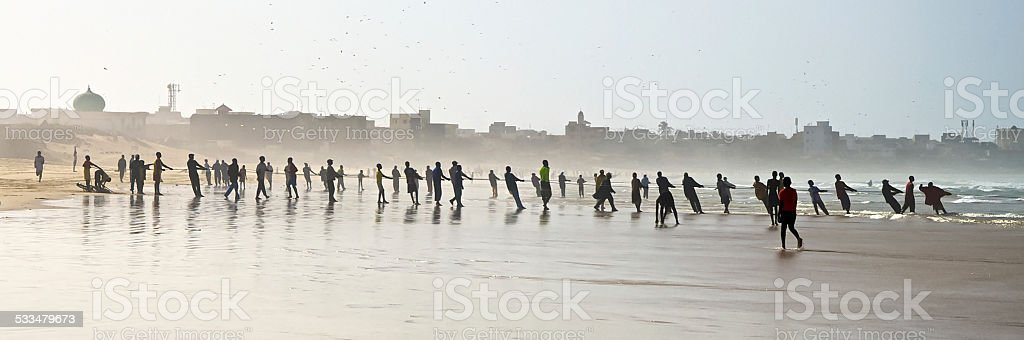 Senegalese Fishermen pulling in their nets stock photo