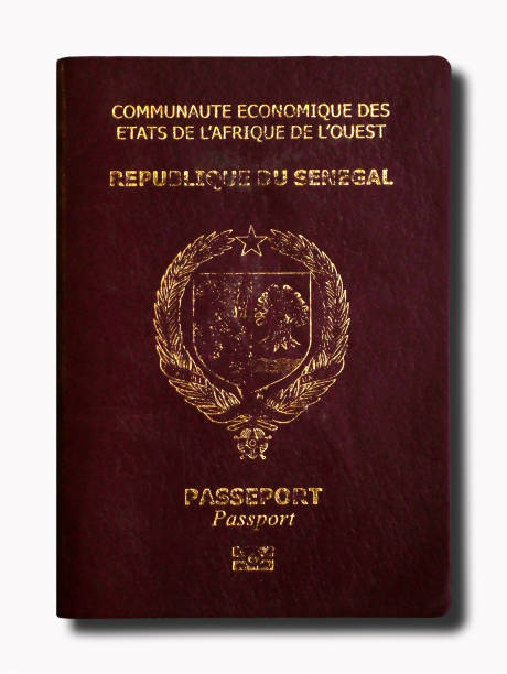 Senegalese passport isolated on a white background stock photo