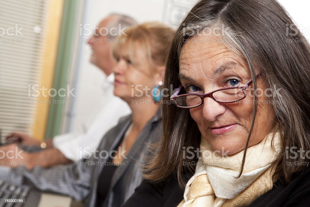 Senior Adult at a Computer Lab With Other People royalty-free stock photo