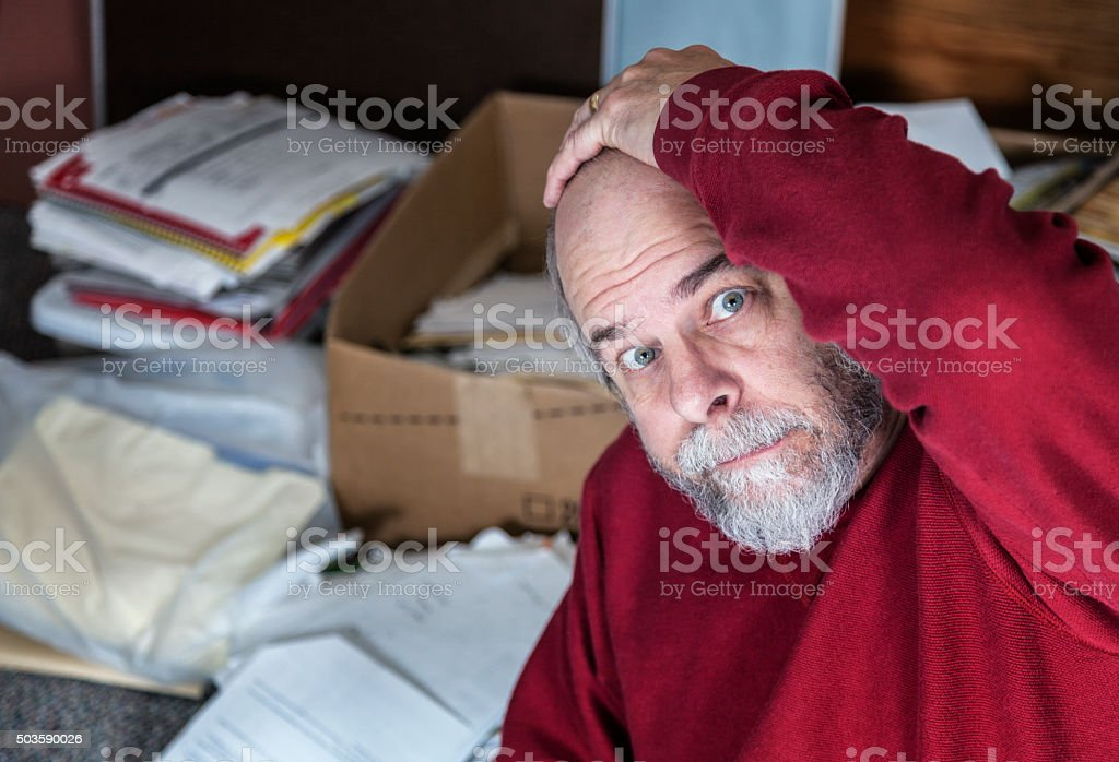 Senior Adult Business Man Overwhelmed In Messy Office Room stock photo