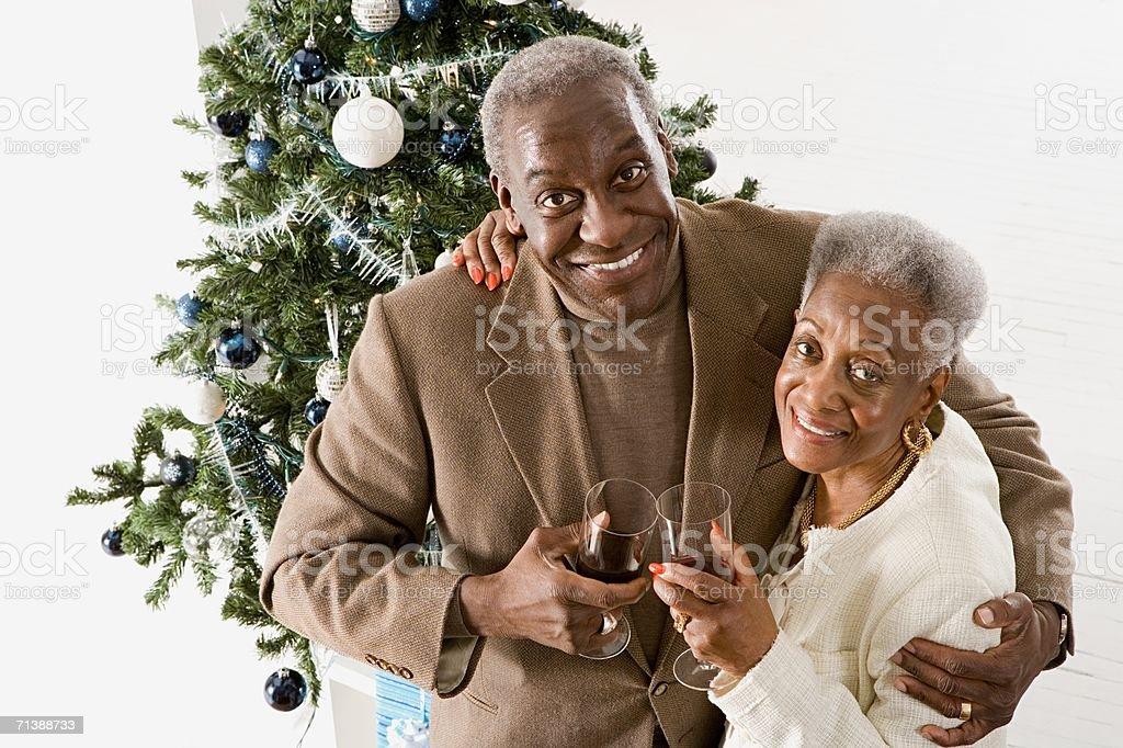 Senior adult couple at Christmas royalty-free stock photo