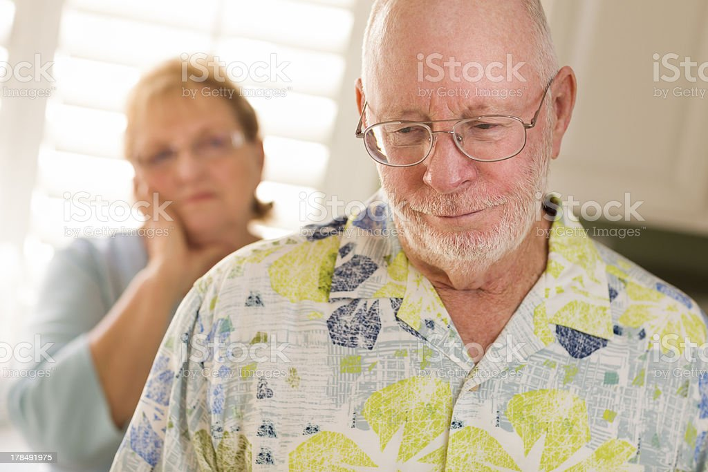 Senior Adult Couple in Dispute or Consoling royalty-free stock photo