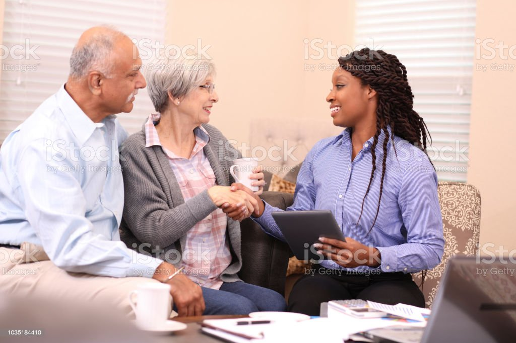 Senior adult couple meets with financial advisor. royalty-free stock photo