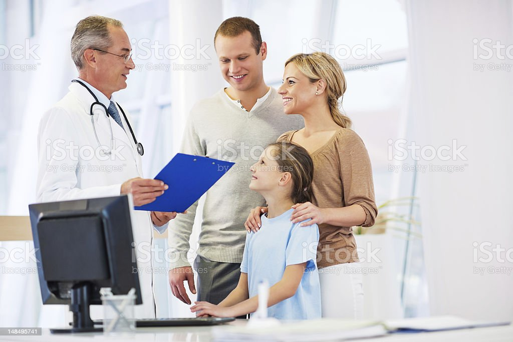Senior adult doctor with his patients. stock photo