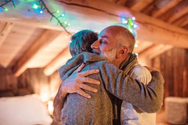 Senior adult embracing for christmas picture id1066489580?b=1&k=6&m=1066489580&s=612x612&w=0&h=mrfkd4igakhg4wsobxuvreemeqvk5svehodvjn1gjx4=