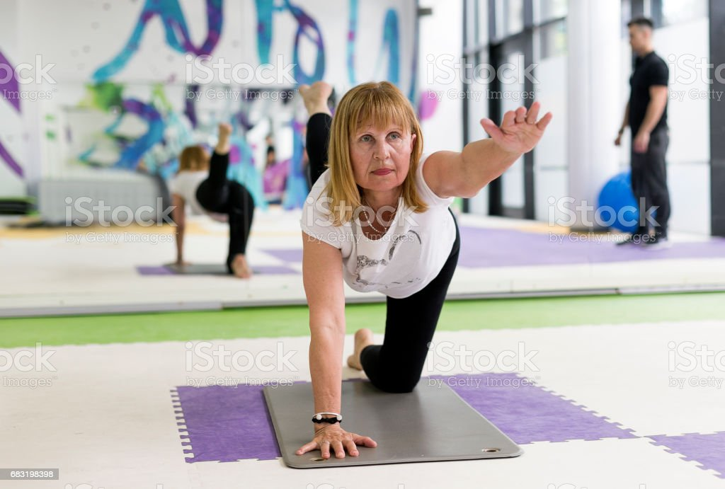 Senior adult exercising with instructor royalty-free 스톡 사진
