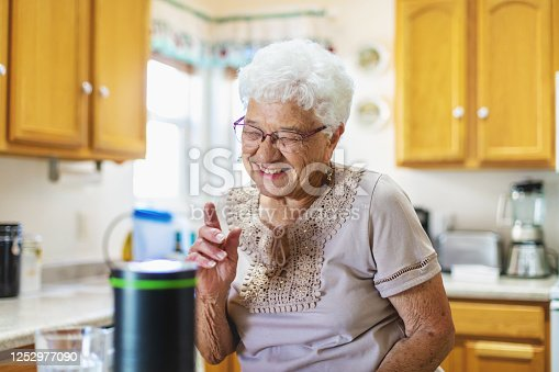 Senior Adult Female in Domestic Residence Kitchen (Shot with Canon 5DS 50.6mp photos professionally retouched - Lightroom / Photoshop - original size 5792 x 8688 downsampled as needed for clarity and select focus used for dramatic effect)