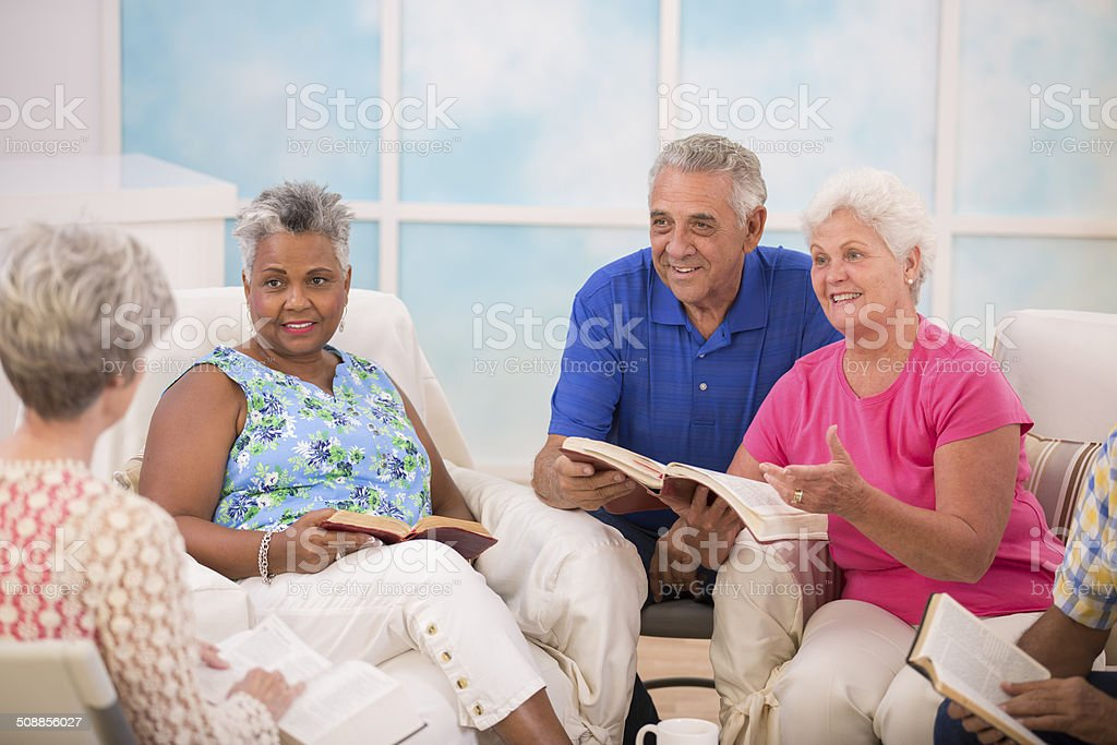 Senior adult friends, couple during bible study group. stock photo