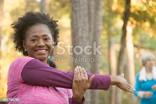istock Senior adult friends exercising outdoors. 932794792
