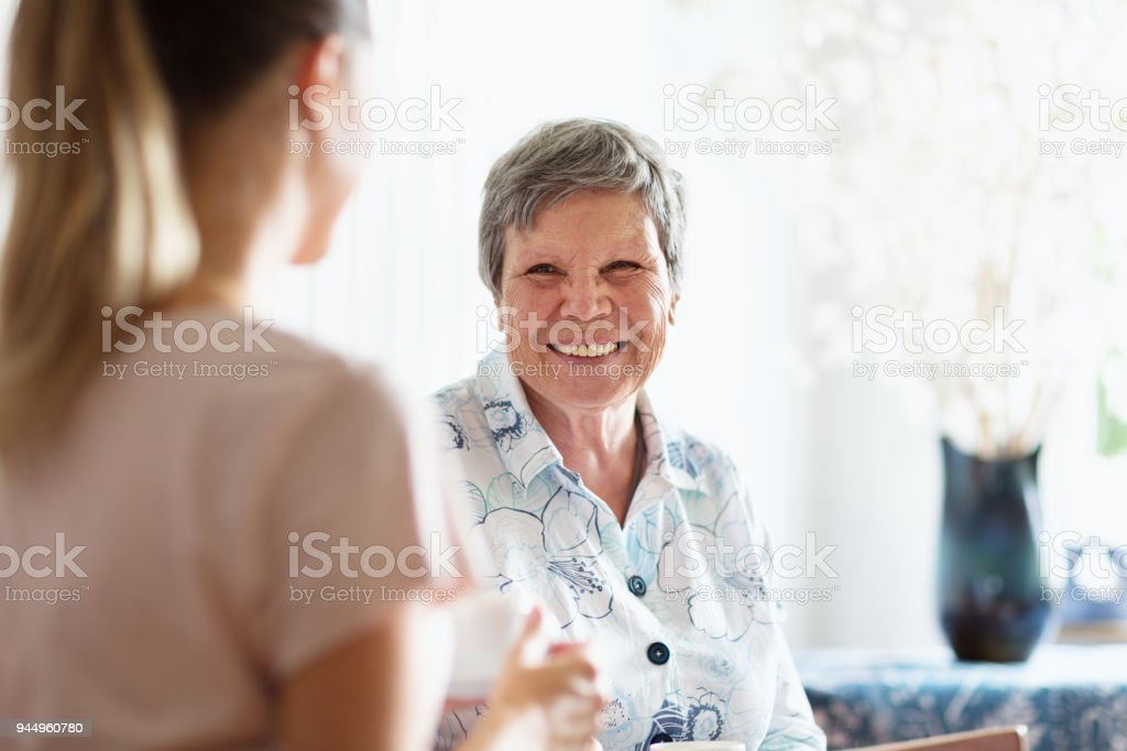 senior adult getting care and assistance stock photo