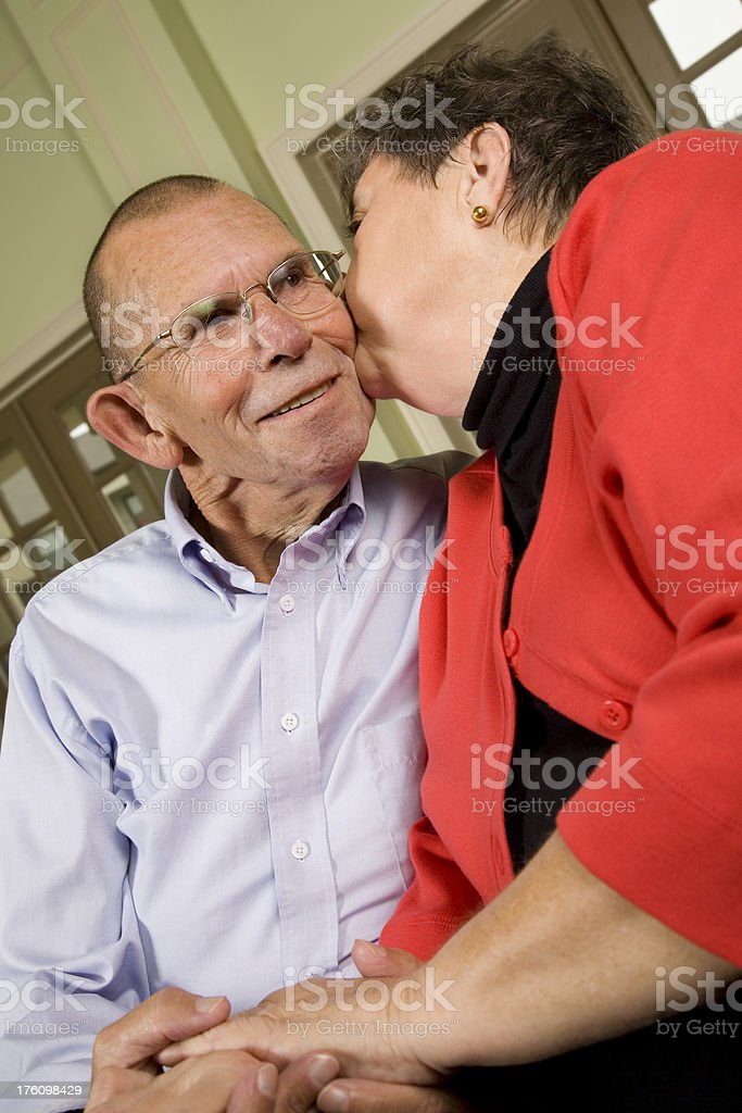 Senior Adult Giving Her Husband a Kiss on the Cheek royalty-free stock photo