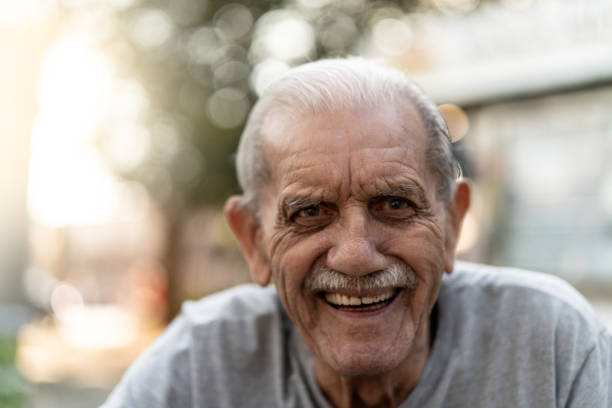 Senior adult male laughing portrait; he is 89 years old stock photo