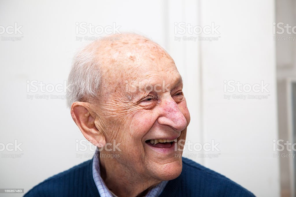 Senior adult male portrait laughing stock photo