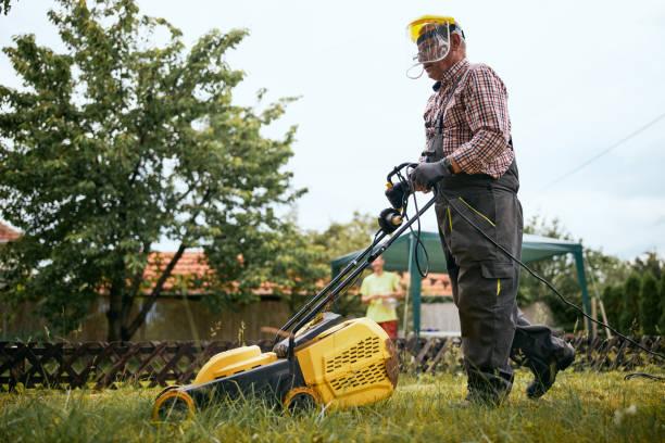Senior adult man doing chores at home stock photo