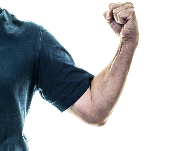 Senior Adult Man Flexing Strong Arm Muscles With Clenched Fist stock photo