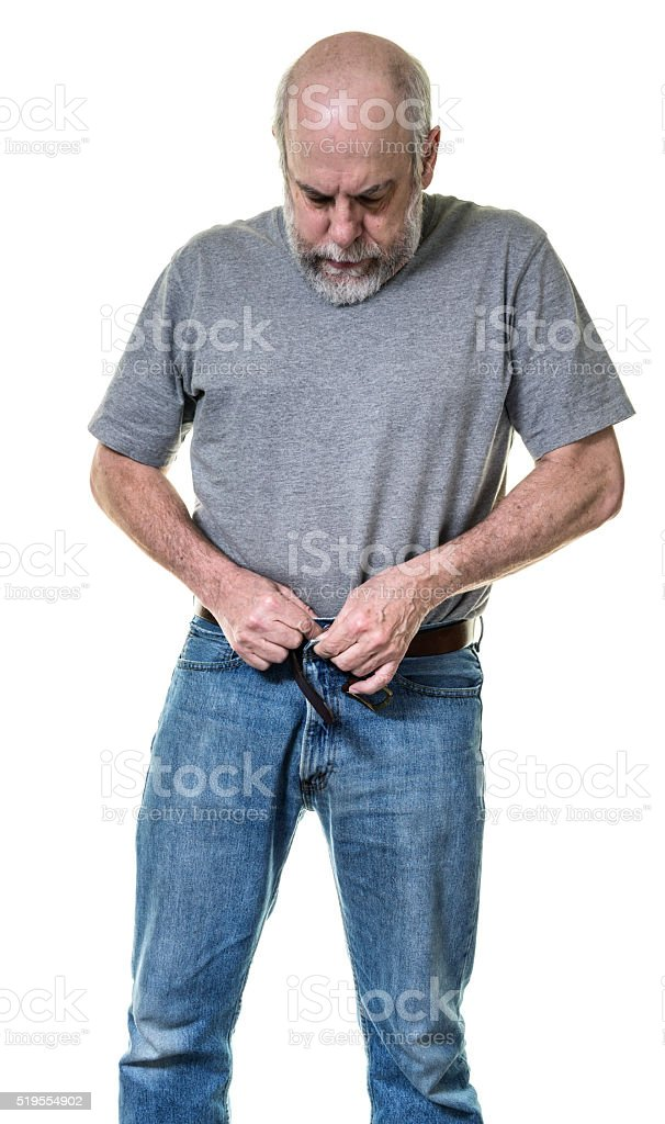 Senior Adult Man Getting Dressed Fastening Blue Jeans Button stock photo