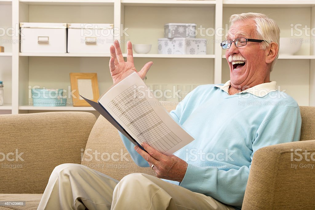 Senior Adult Man reading an important document royalty-free stock photo