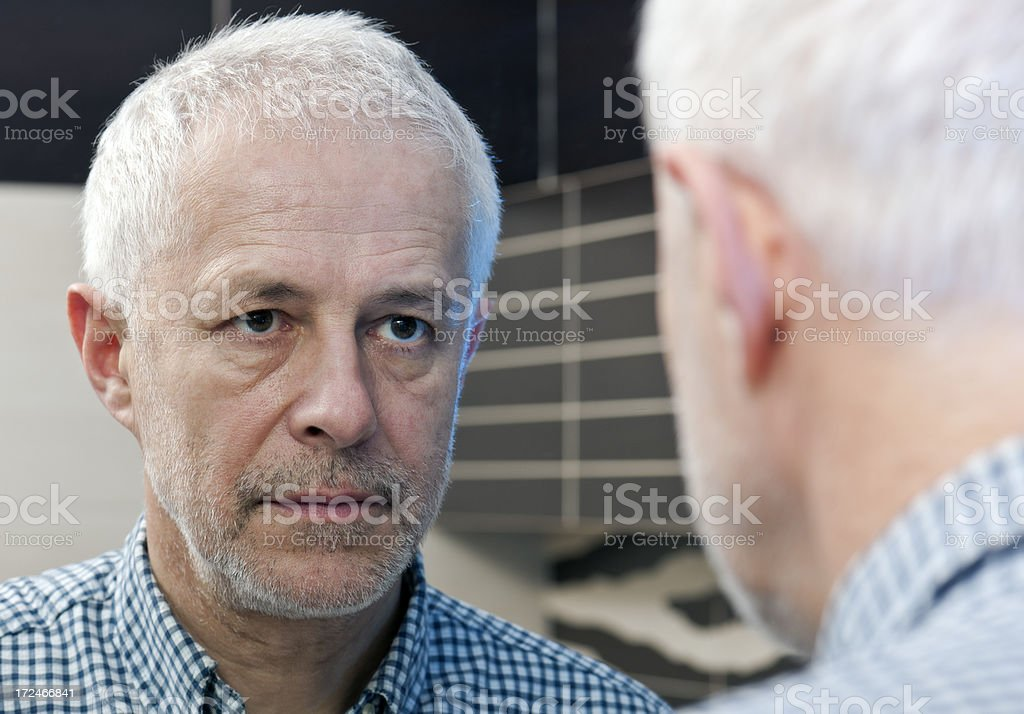 Senior adult man, self portrait, mirror reflection royalty-free stock photo