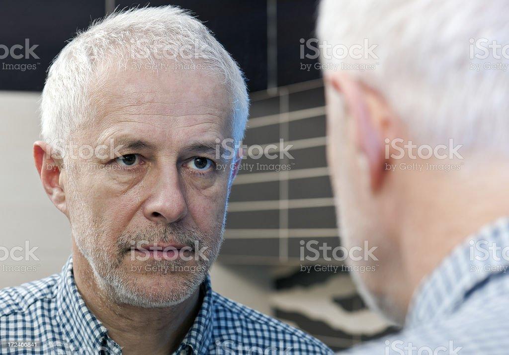 Senior adult man, self portrait, mirror reflection stock photo