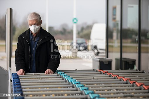 Senior Adult Man Wearing Protective Face Mask When Visiting Supermarket.