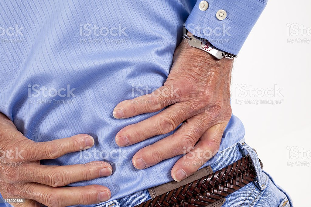 Senior adult man with back pain, backache.  Rubbing lower back. royalty-free stock photo