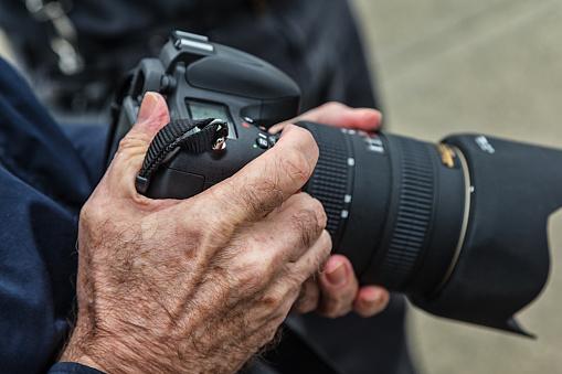 Senior Adult Photographer Holding Camera