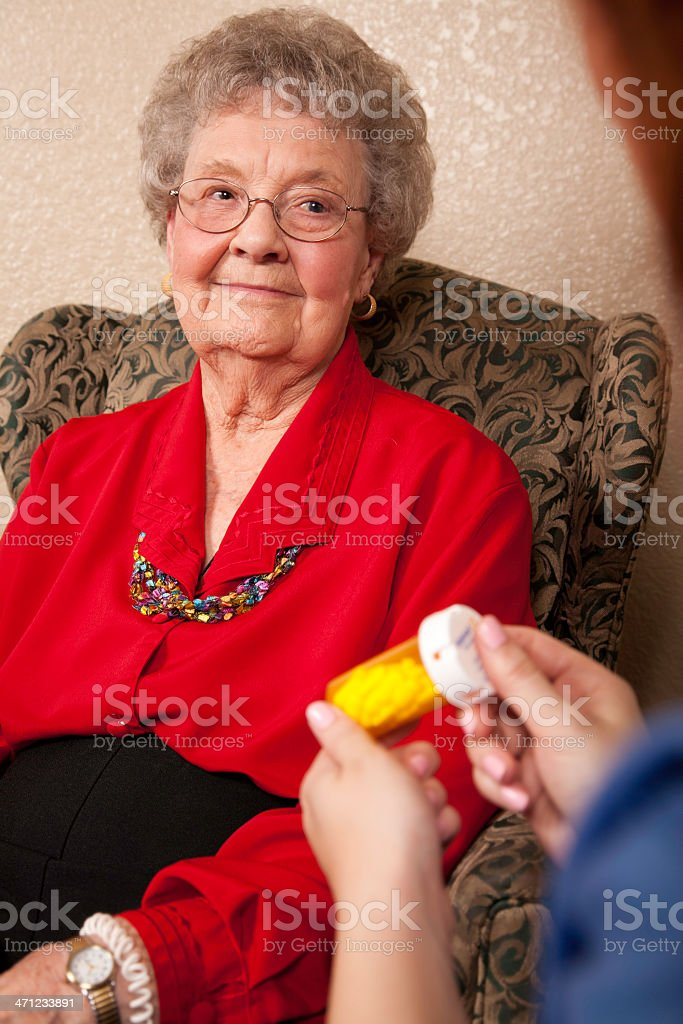 Senior Adult Receiving Instructions on Medication royalty-free stock photo