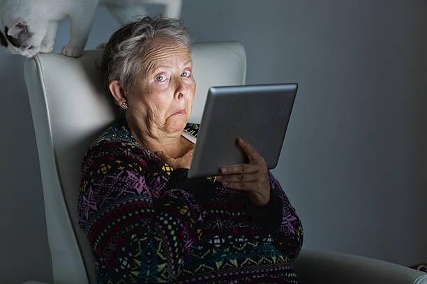 Senior adult surprise cat digital tablet picture id522218405?b=1&k=6&m=522218405&s=612x612&w=0&h=7nvo8dkh2o rnatqmoduken195hefzgw f8paeq7qeg=