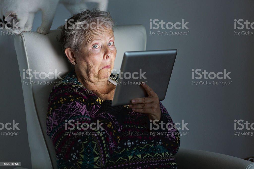 senior adult surprise cat  digital tablet stock photo