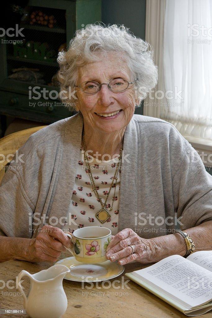 senior adult taking a coffee break royalty-free stock photo