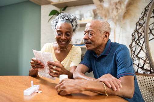 Senior adult taking medication