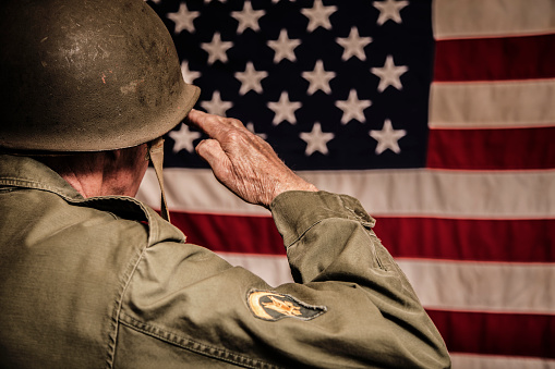 Senior adult USA armed forces military with American flag.