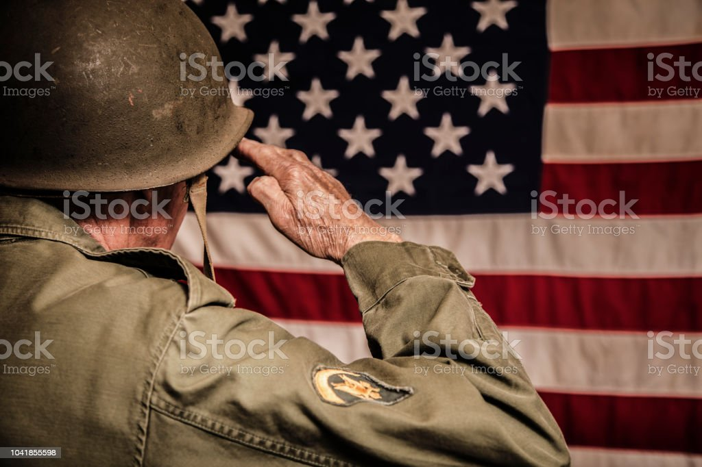 Senior adult USA armed forces military with American flag. stock photo