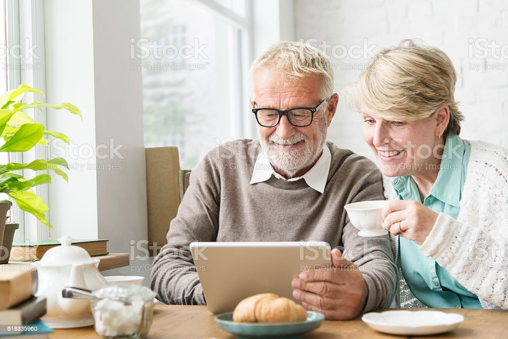 Senior Adult using Digital Device Tablet Concept - foto de acervo