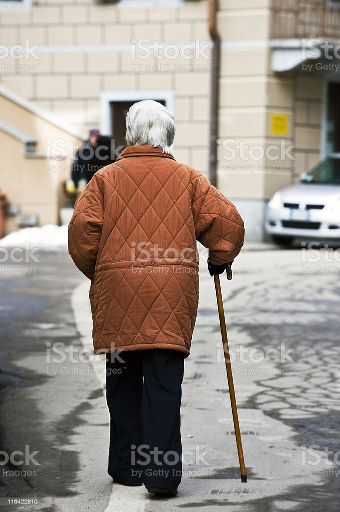 Senior Adult Walking with Cane. Color Image stock photo