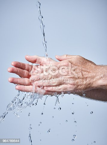 Senior Adult Washing Hands Under Running Water Stock Photo & More Pictures of Adult