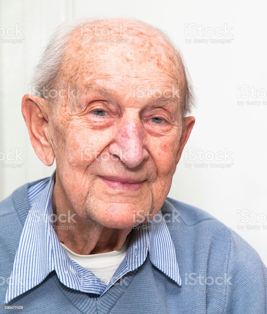 Senior adult with a blue sweater and striped shirt stock photo