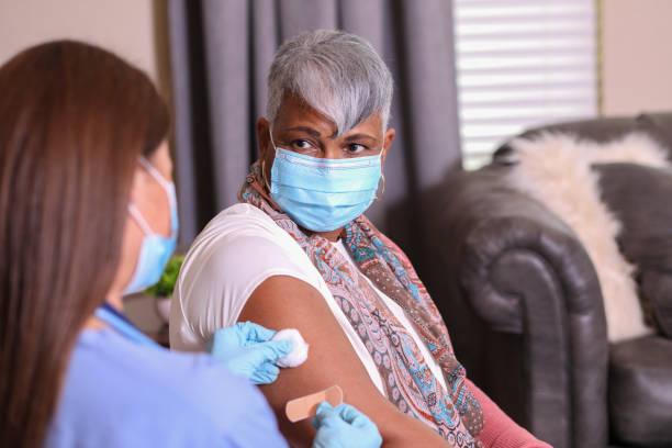 Senior adult woman and home health care nurse. stock photo